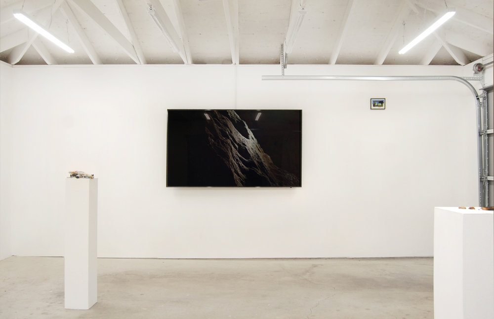 Forced Autumn , installation view at Chicago Manual Style, 2017. From left, Allora & Calzadilla,  La Noche Que Volvimos a Ser Gente (The Night We Became People Again) , 2017. Digital HD colour video with sound, Courtesy Gladstone Gallery, Brussels and New York, and CARNE Adriana Martínez,  FIN Postcard , 2017, vinyl on postcard.