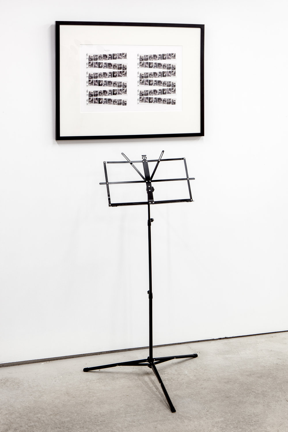 Barbara Bloom (b. Los Angeles, California, 1951),  Song: Gap Scales (me too) , 2008. Archival digital print and music stand. Framed Dimensions: 24 x 30 inches (variable for stand placement). Edition AP 1 of 2. Courtesy David Lewis Gallery, New York. Photo: Daniel Hojnacki.