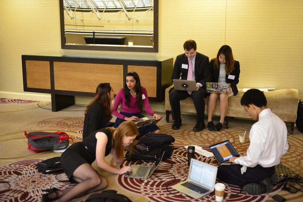 Delegates caucusing at UPMUNC 51