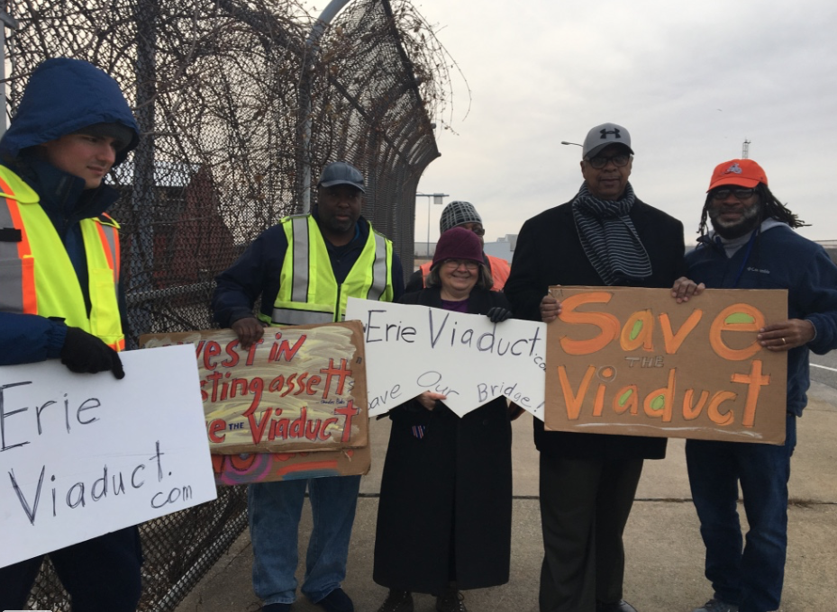 Protesters protesting peacefully including Councilman Andre' Horton (far right) and Rev. Charles Mock, to the left of Horton. (Image - Lisa Austin)