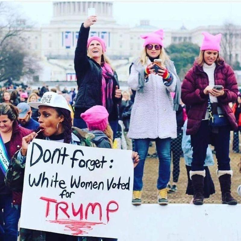 Angela Peoples holding sign (Kevin Banatte)