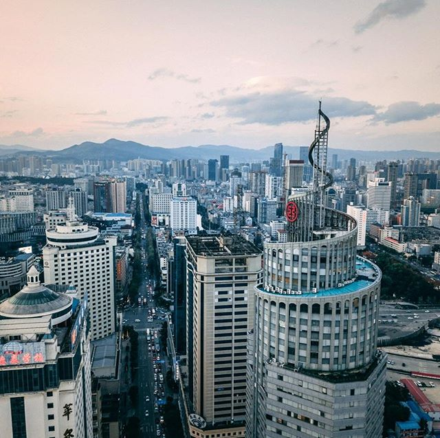 Skyscrapers only interrupted by the distant mountains 🌆 . . . . #china #yunnan #kunming #photographer #citybreak #cityscape #skyline #sony #adventure #travelling