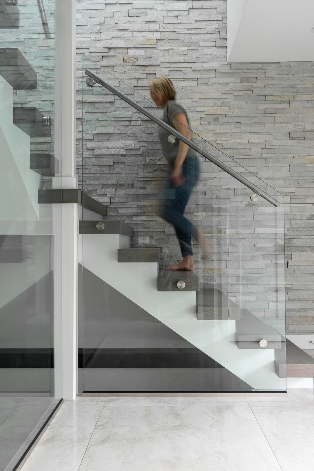 contemporary stairs with glass rail