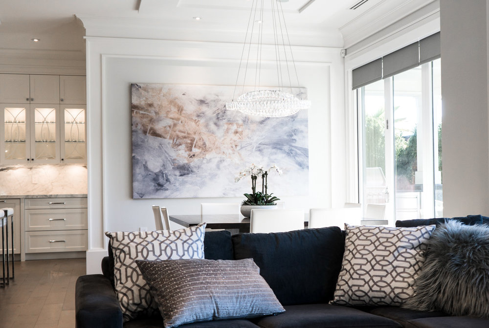 Transitional living room with art