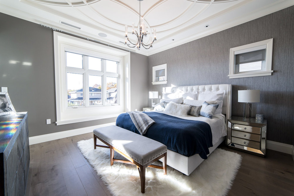 Transitional master bedroom with ceiling detail