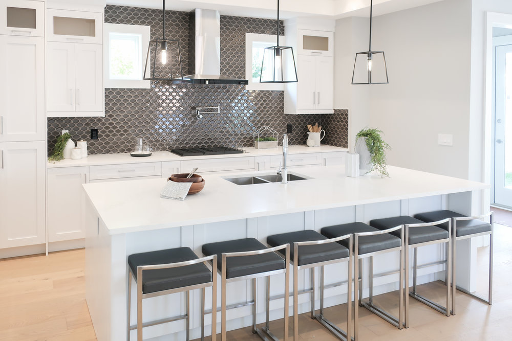 contemporary kitchen with black pendant light