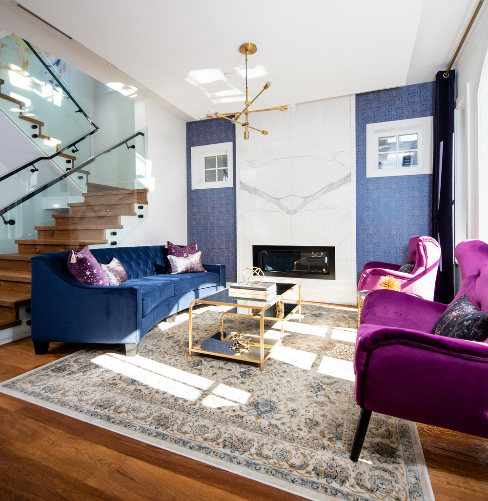 transitional colorful living room with gold lighting