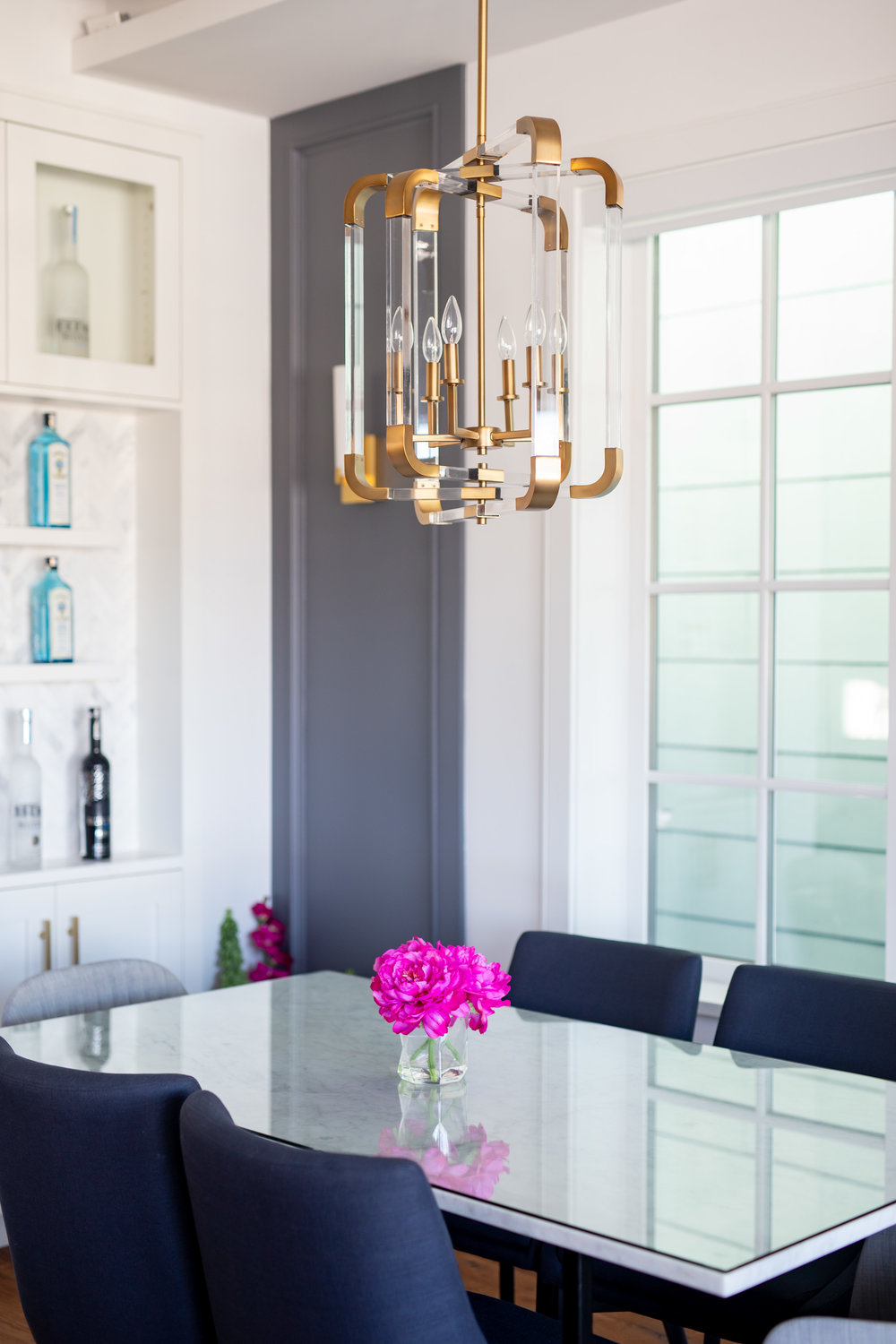 gold lighting above dining table