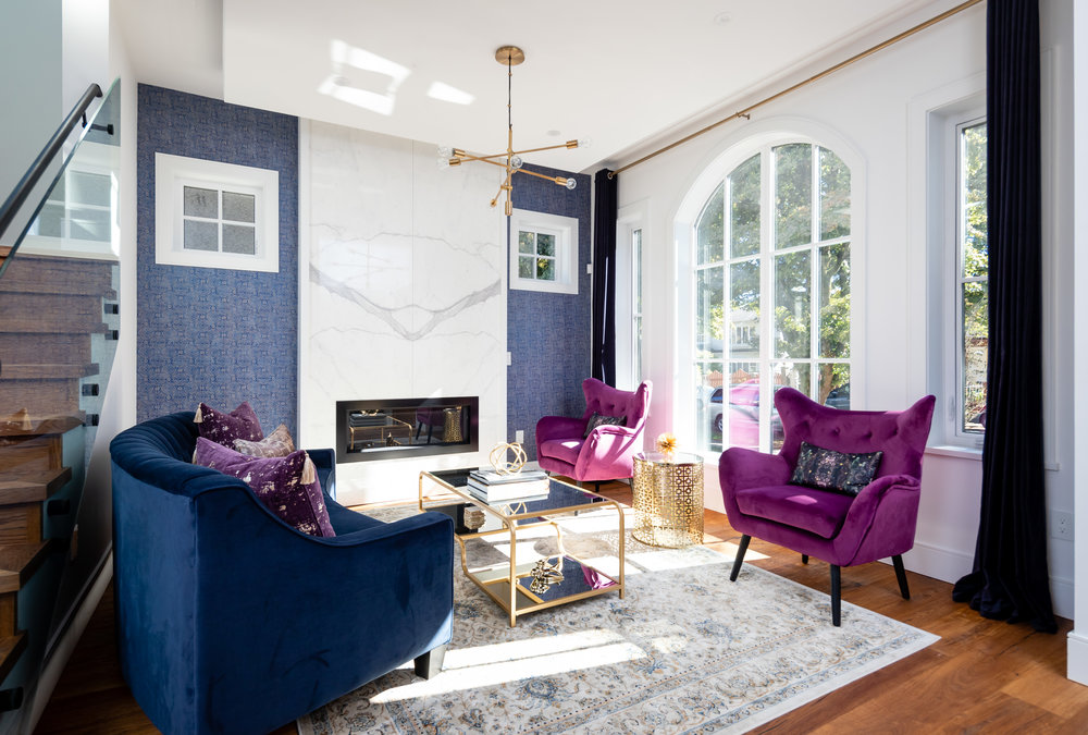 colorful living room with gold chandelier