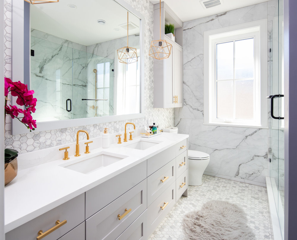 master bathroom with gold faucets