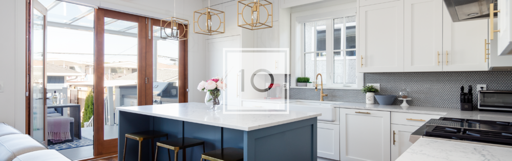Transitional white kitchen with blue island and gold fixtures