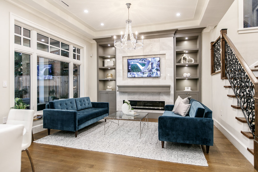transitional family room with chandelier