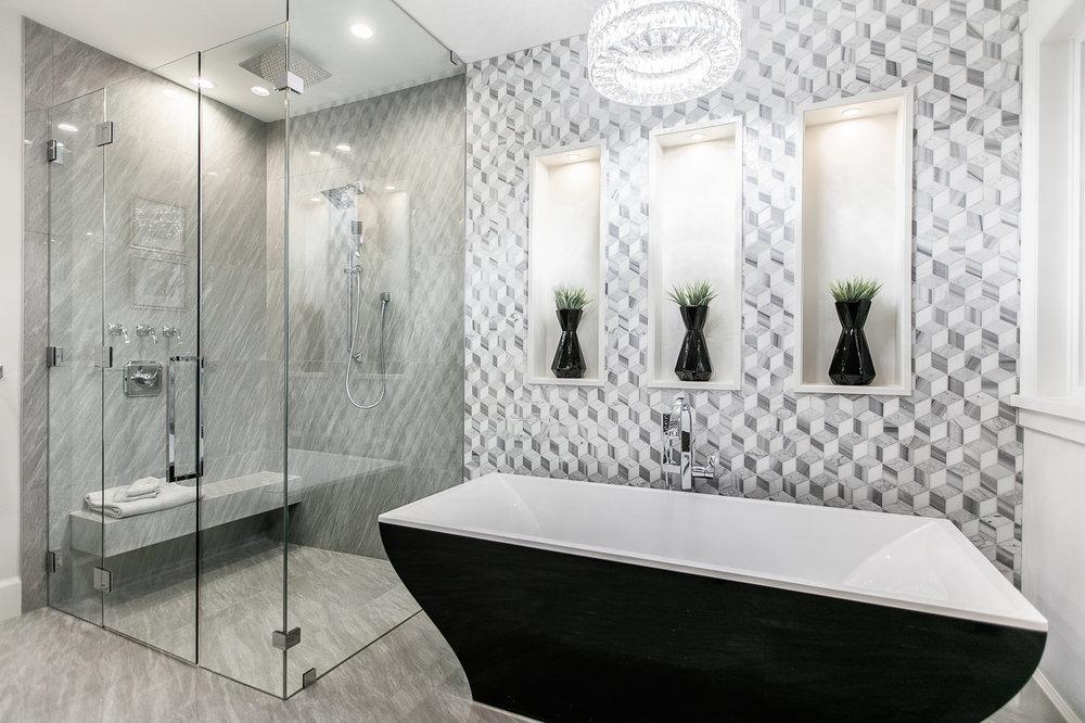 freestanding black bath tub
