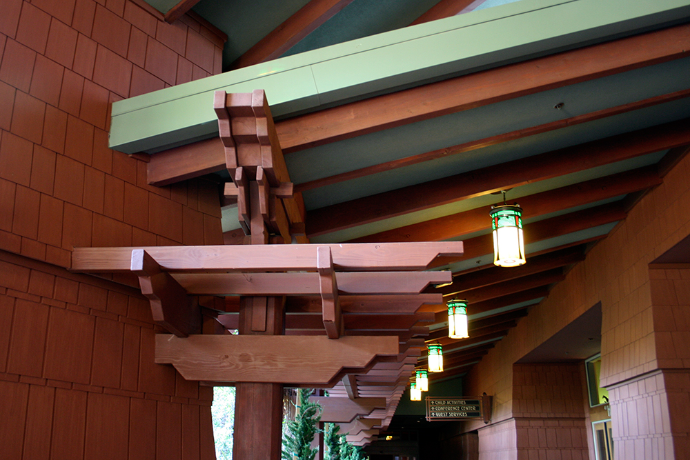 Exposed beams on the walkway to the pool area.