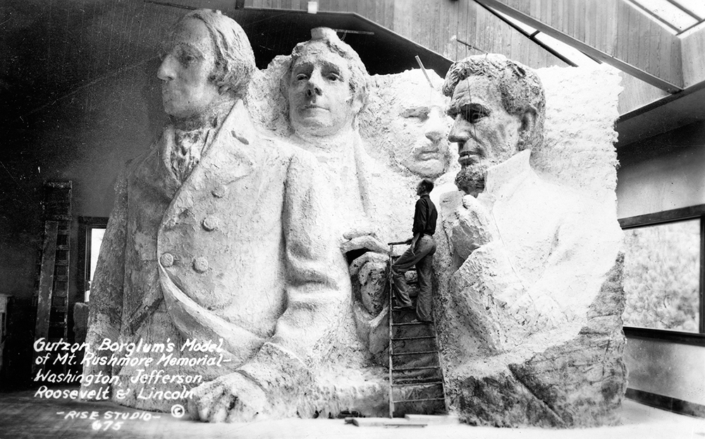 Borglum with his concept model for the monument, 1936,  Public Domain .