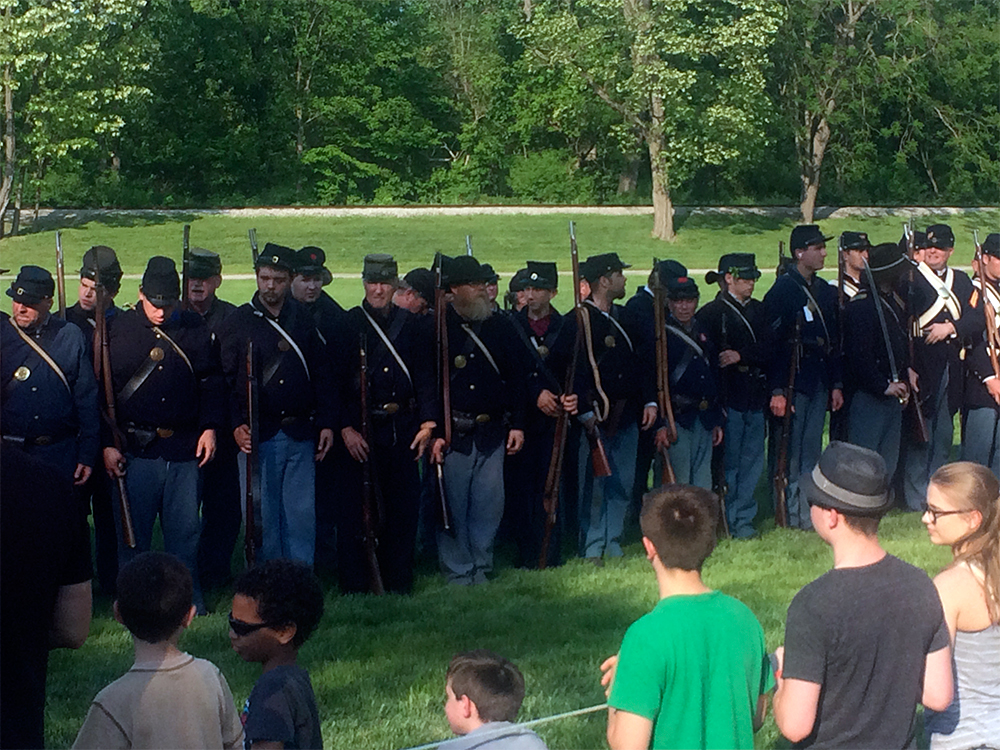 Union troop reenactors on the battlefield after their tactics demonstration.