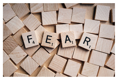 "Scrabble tiles spell out the word, ""fear""."