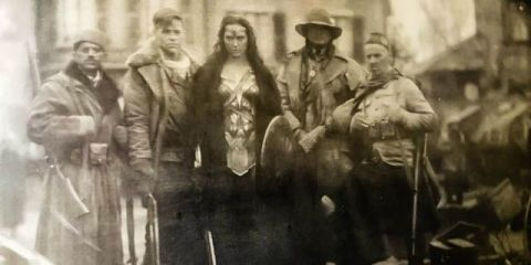 Diana poses with her heroic companions at the end of Wonder Woman.