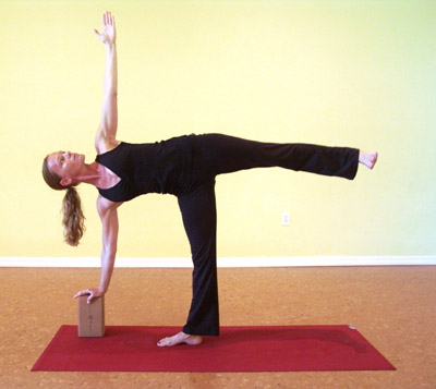 Use a block or a chair to help you out in half moon pose. Props are our friends!