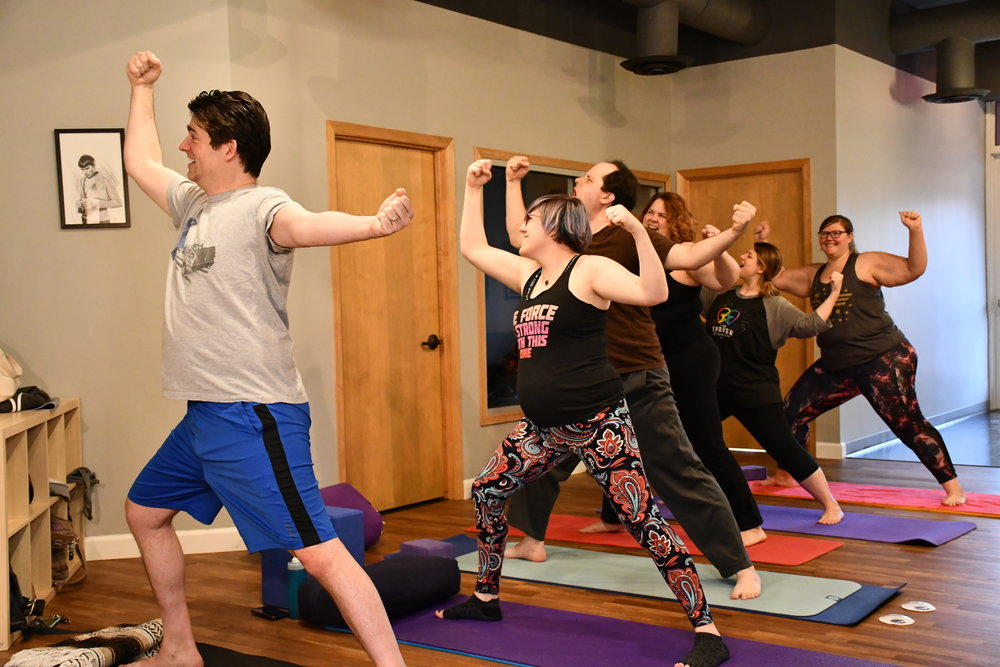 Yogis in Warrior 2 during a YogaQuest narrated yoga class