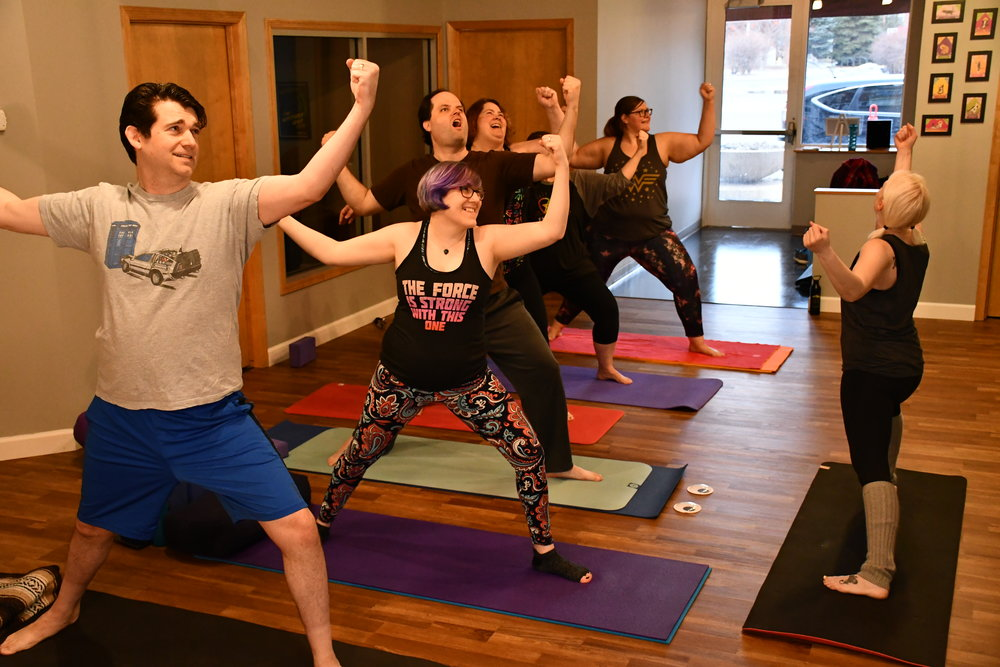 Comic Con attendees participate in a YogaQuest Yoga class.