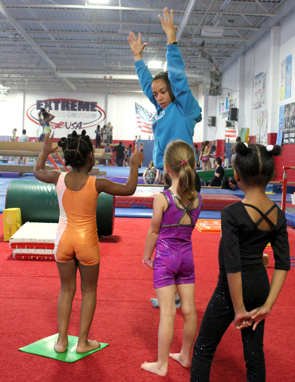 Reach for the sky! Thursday, October 18, 2018 was just another hard days work at Extreme Gymnastics USA. Gymnast instructor Lisa teaching the future great gymnast.