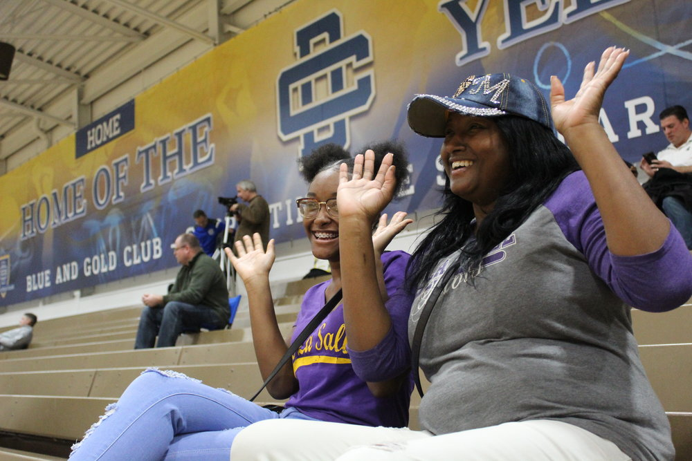 Detroit Country Day School fans, Jalissa and Amber cheer after yet another win for the men of Detroit Country Day School.