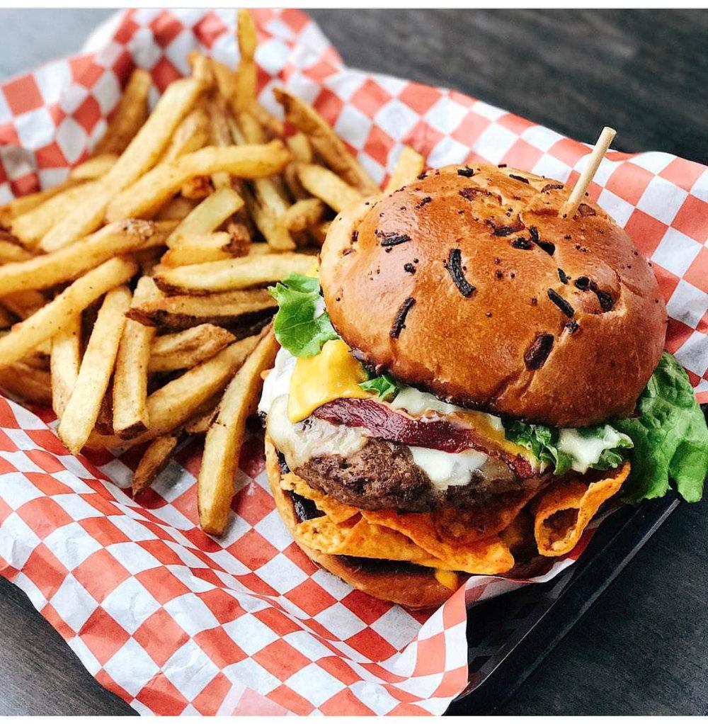 Onion bun burger with fries
