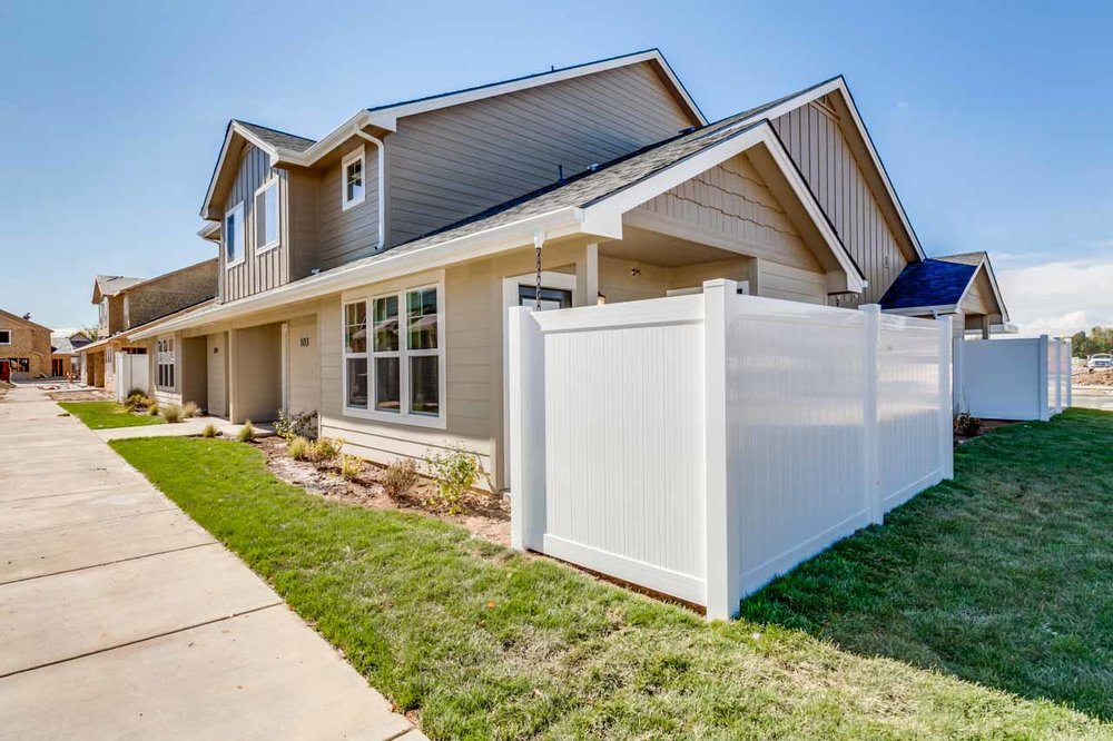 Stonesthrow-town-home-exterior-with-fenced-yard.jpg