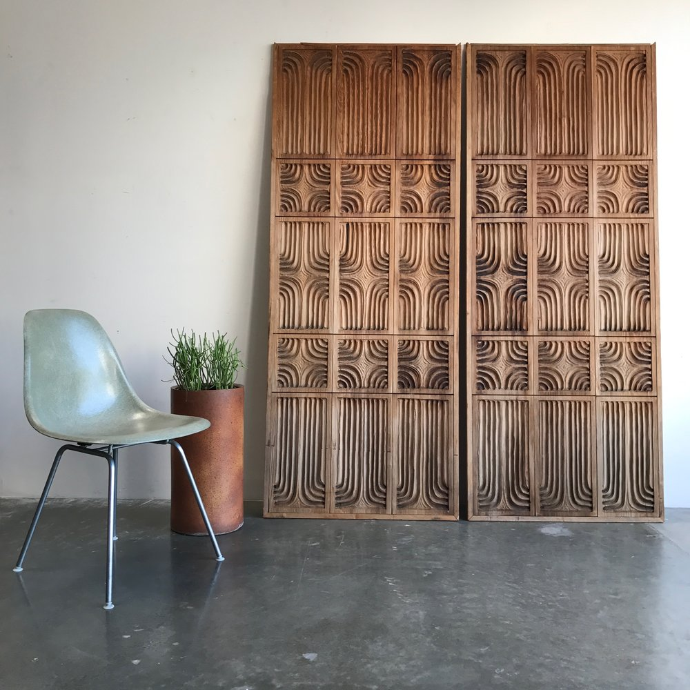 eames sea foam chair and wall partition