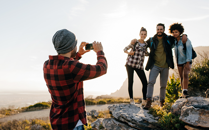 Website_0000s_0003s_0006_Group-of-people-on-hiking-taking-photographs-641553182_2125x1417.png