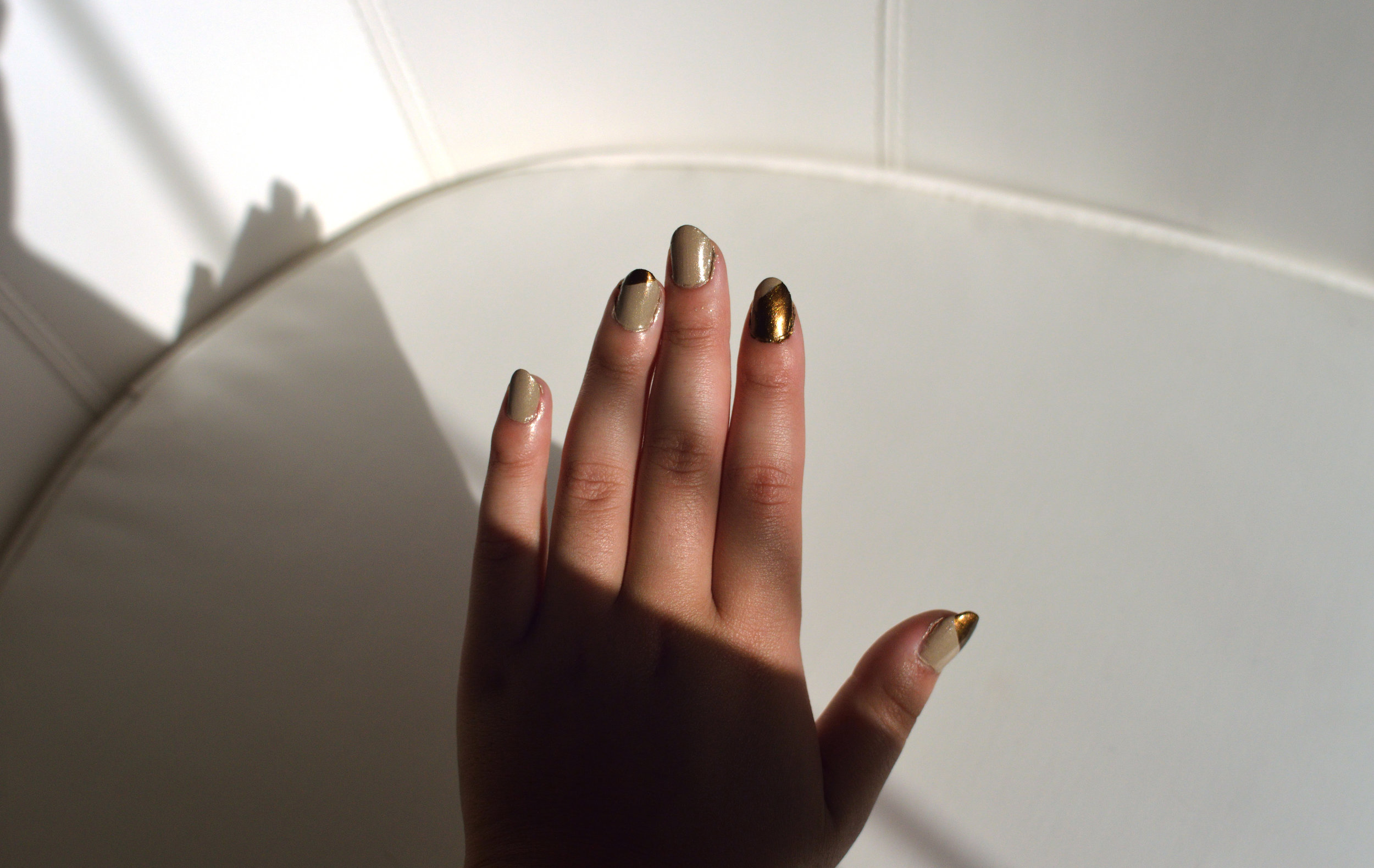 Gold nail polish manicure by Tiffany and Couture