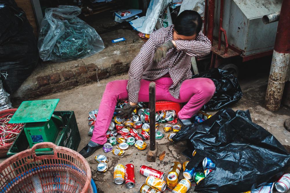 Hanoi woman sorting out the empty cans for recycling.