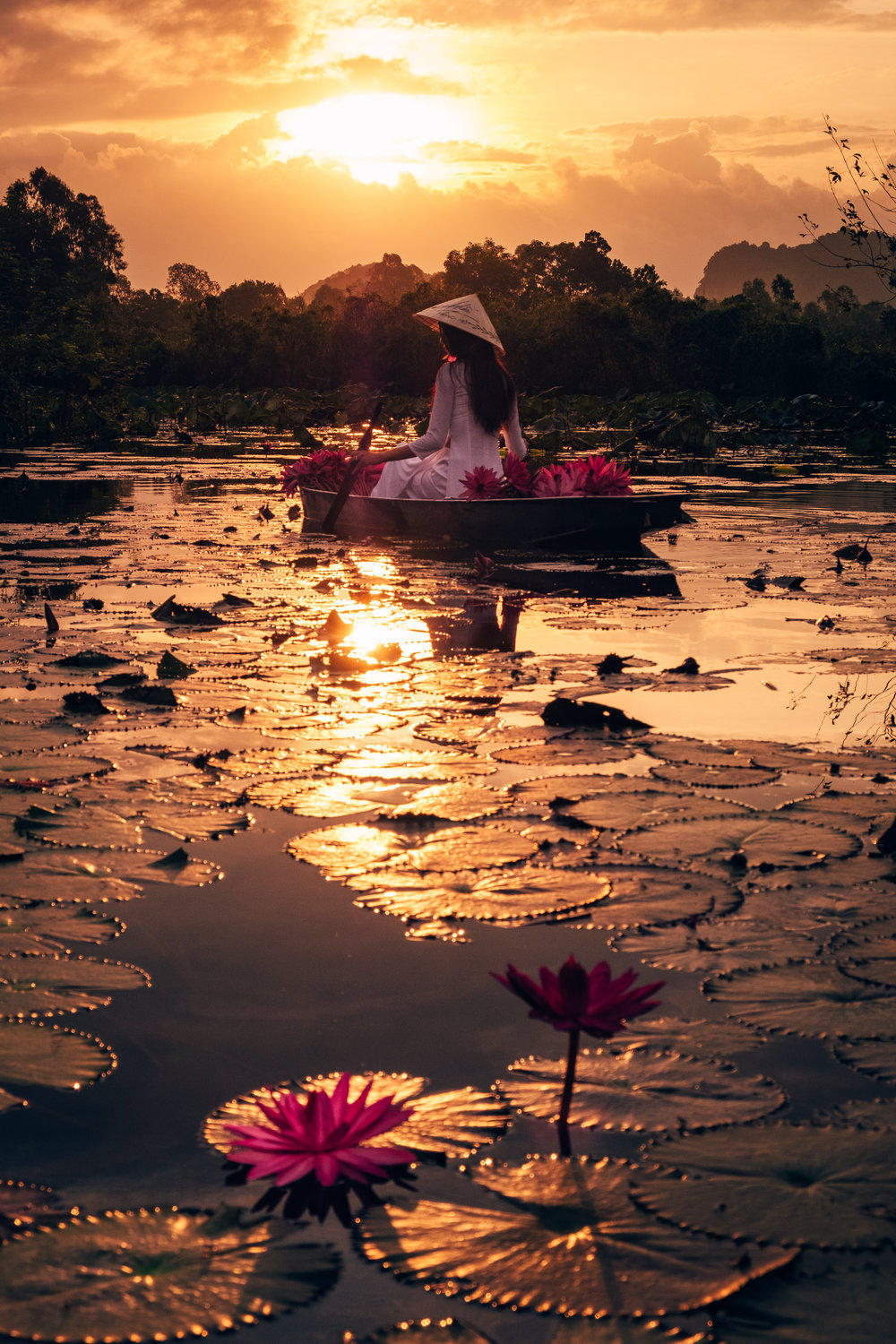 A boat riding during beautiful sunrise in perfume pagoda in viet