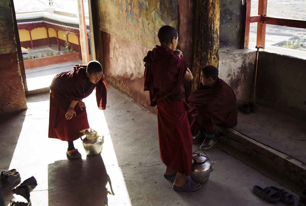 Young Buddhist monks resting near the prayer hall