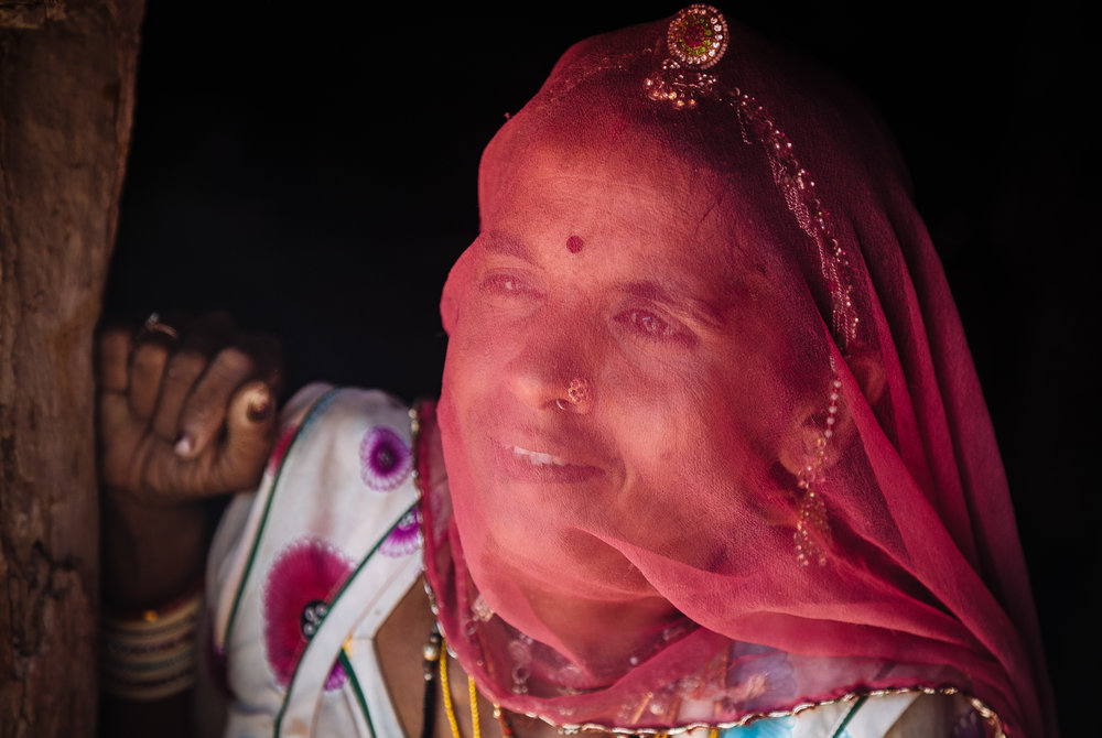 A rajasthani woman at the entrance of her clay house. In few par