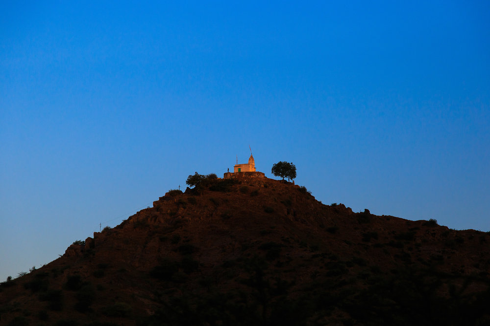 First sunlight of the day falling directly on the hilltop Savitr