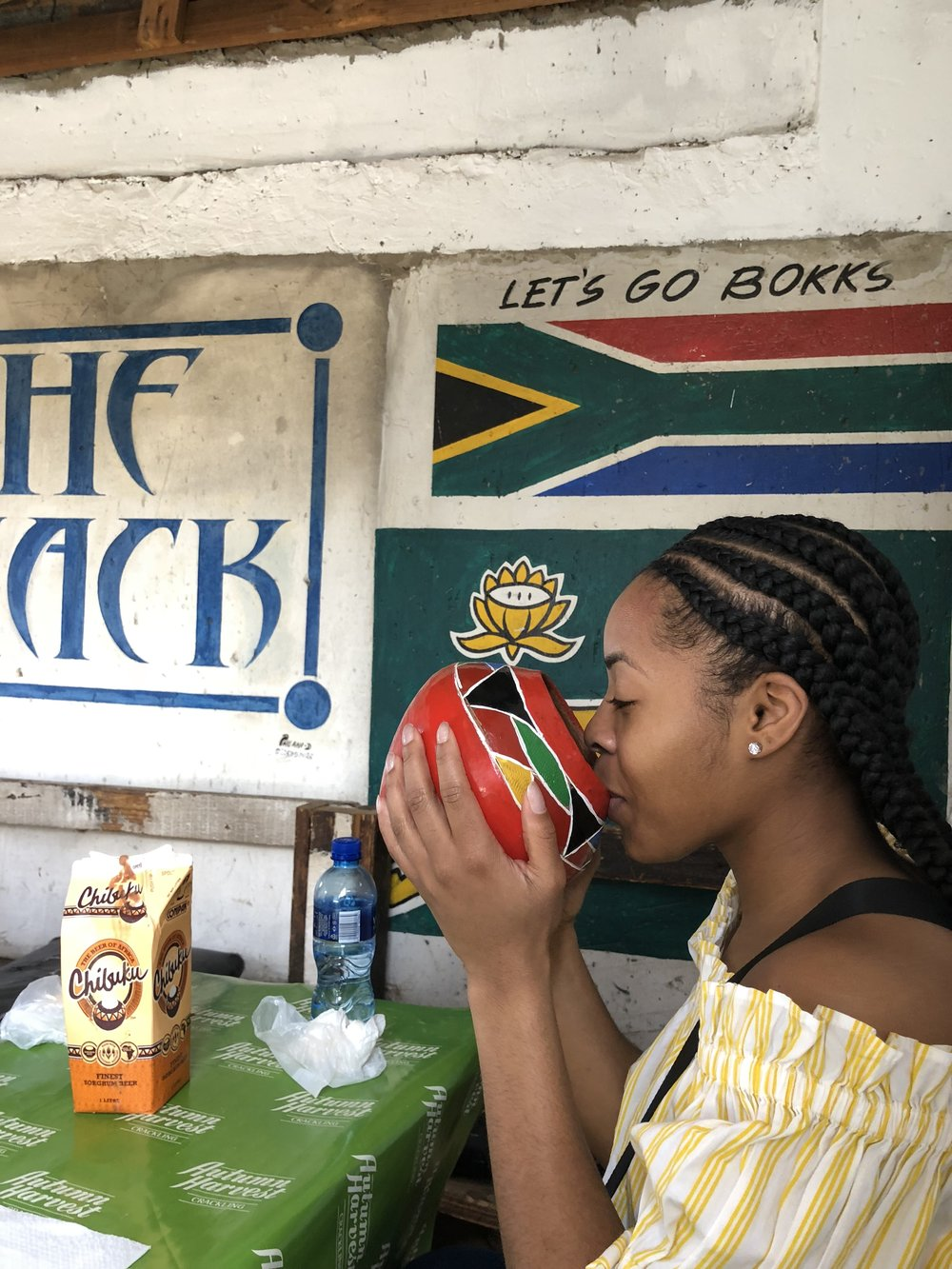Drinking Chombuku (African Beer) from a Calabasch in South Africa -Alyssa 2018