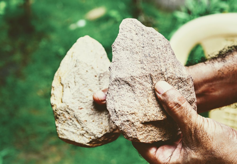 Handaxes are considered as early artistic creations of our ancestors. In the foreground is one made by Akhilesh, a copy of the prehistoric tool in the background that was found in Attirampakkam.