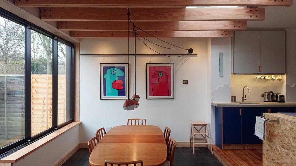 Douglas Fir beams hang from hidden steel beam above