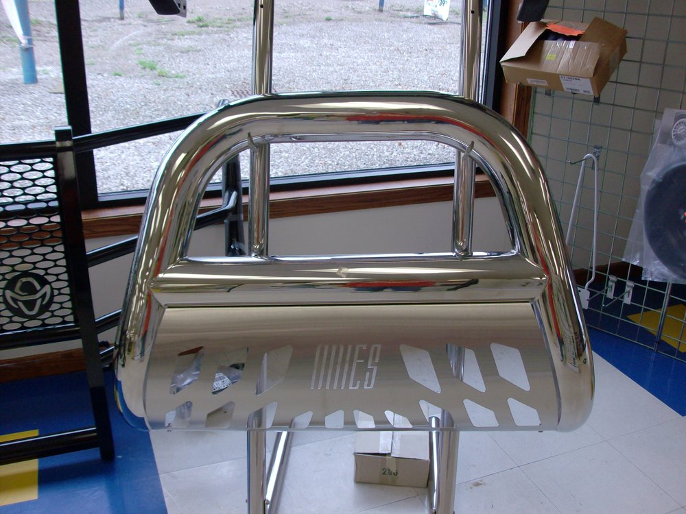 45-3007  Aries grill guard for a 2009-C F150. Stainless steel with skid plate, showroom price $599.99.