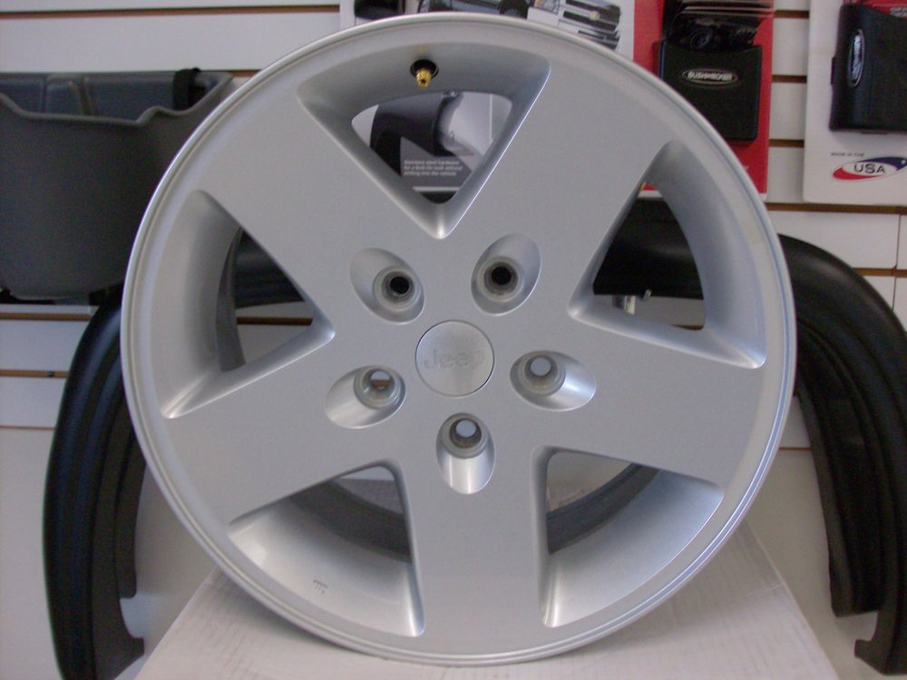 OEM Jeep Wrangler 2007-2018 rims. 5 on 5.5 lug pattern. Showroom price $400.00 for all 5 rims.