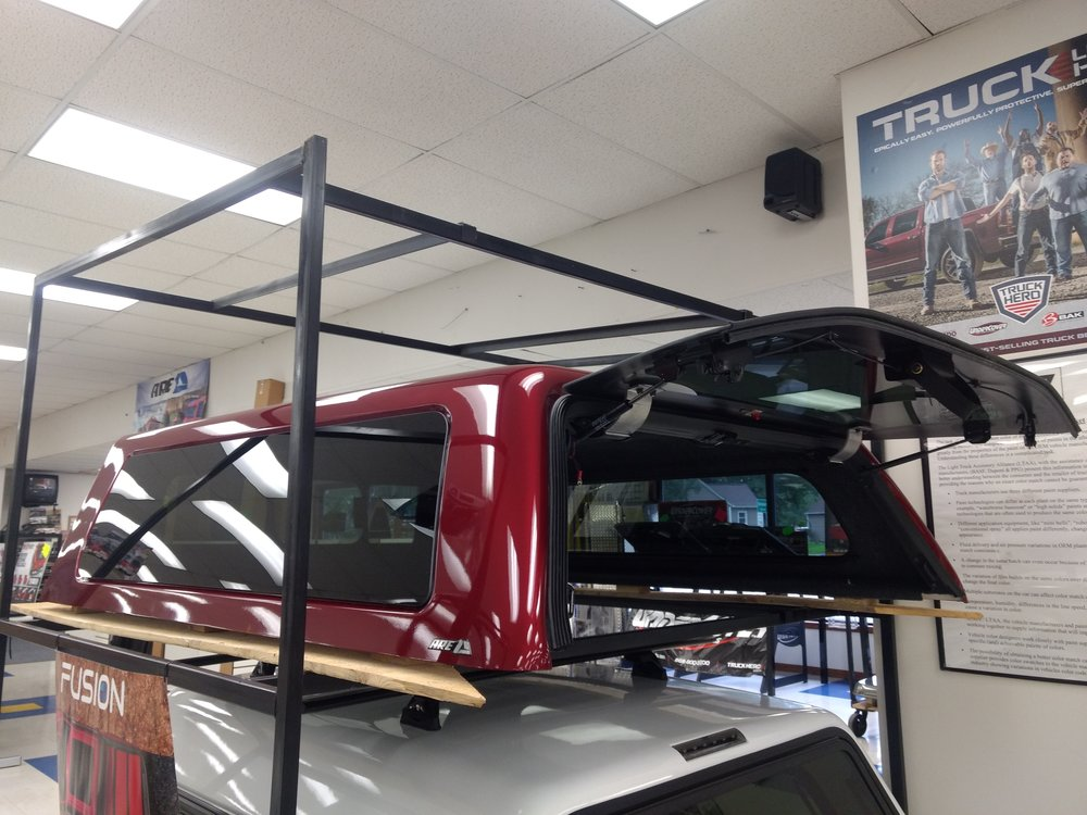 "N3488501  A.R.E. CX Revo series for a 2015-2018 F150 6'5"" bed. Paint code is RR Red. Frameless all glass side windows, front sliding window, foss lining, tailgate formed all glass rear door, 12v dome light with ActiveTilt, and 3rd brake light"