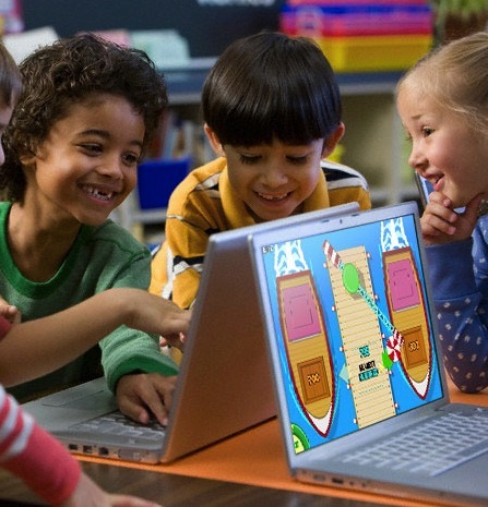 Engaged elem. kids at laptops.jpg