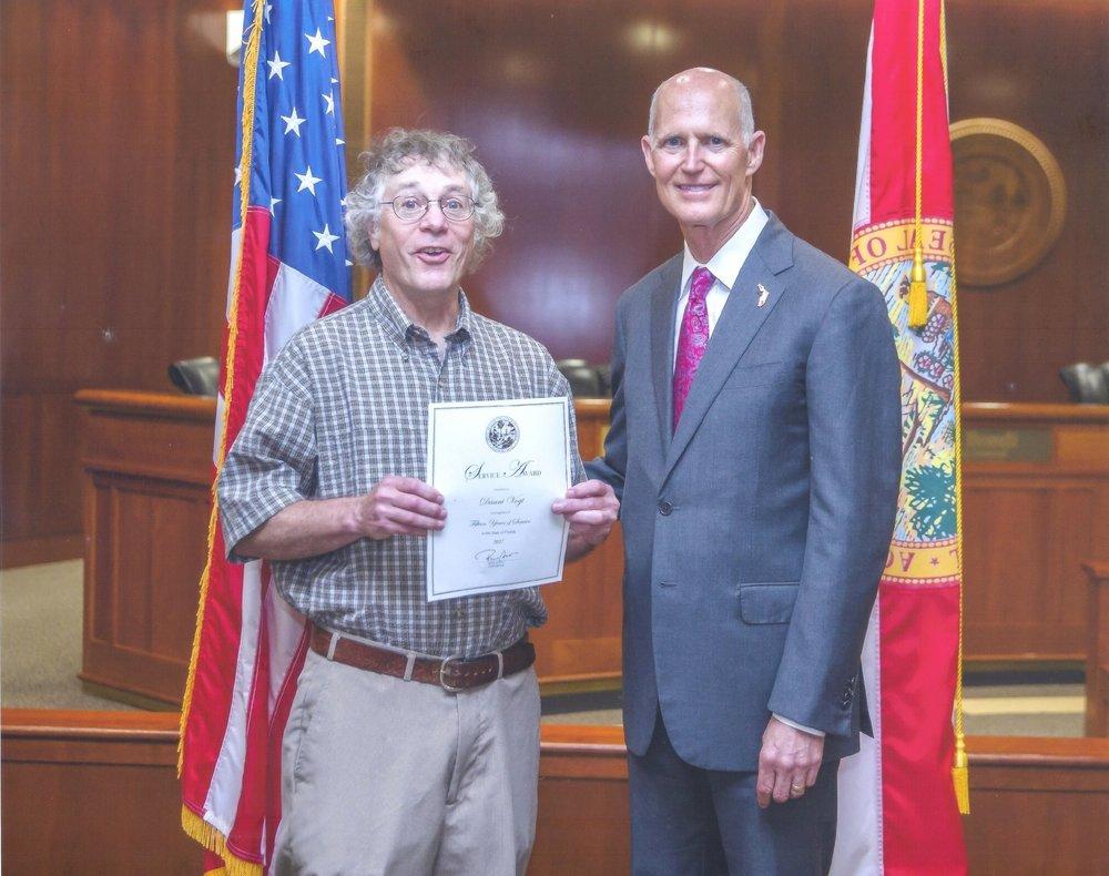 Danni (left) with Florida Gov. Rick Scott in 2017