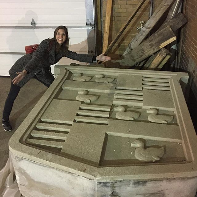 The biggest Cadillac symbol we've ever seen! Jen is demonstrating how monstrous this thing is. Look at the third photo for ceiling symbols too!  #cadillac #detroit #oldarchitecture #historic