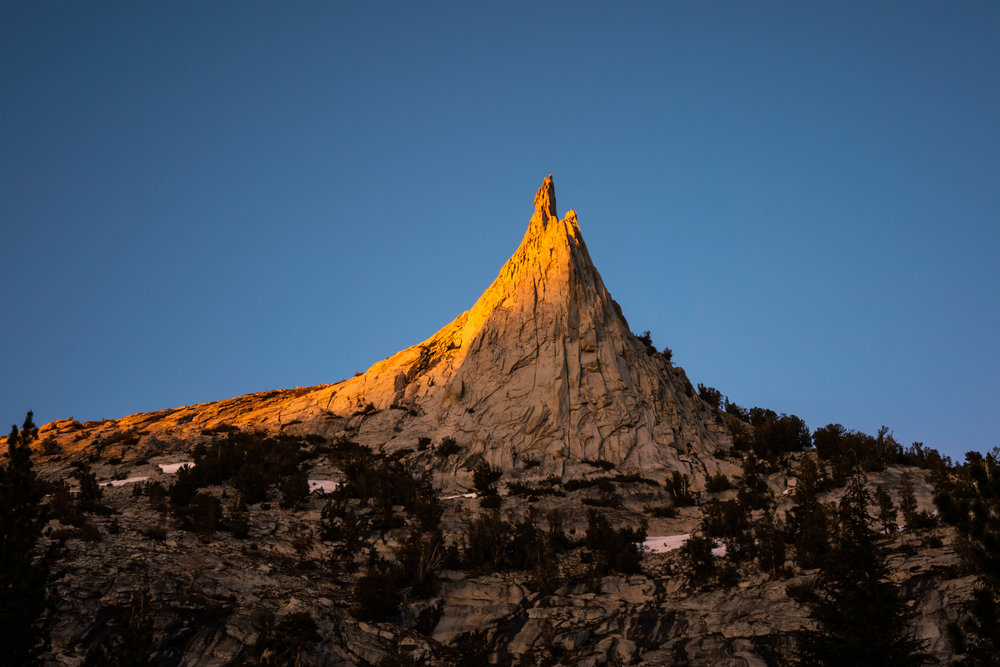 The day's last light upon Cathedral Peak and Eichorn Pinnacle.
