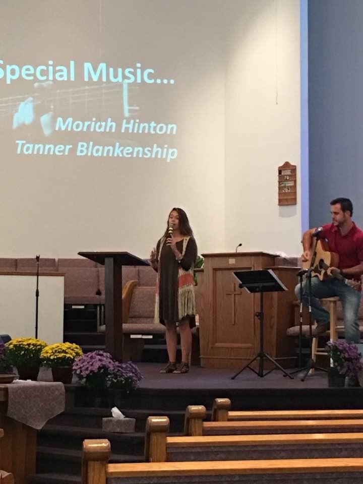 Moriah singing during a church service.