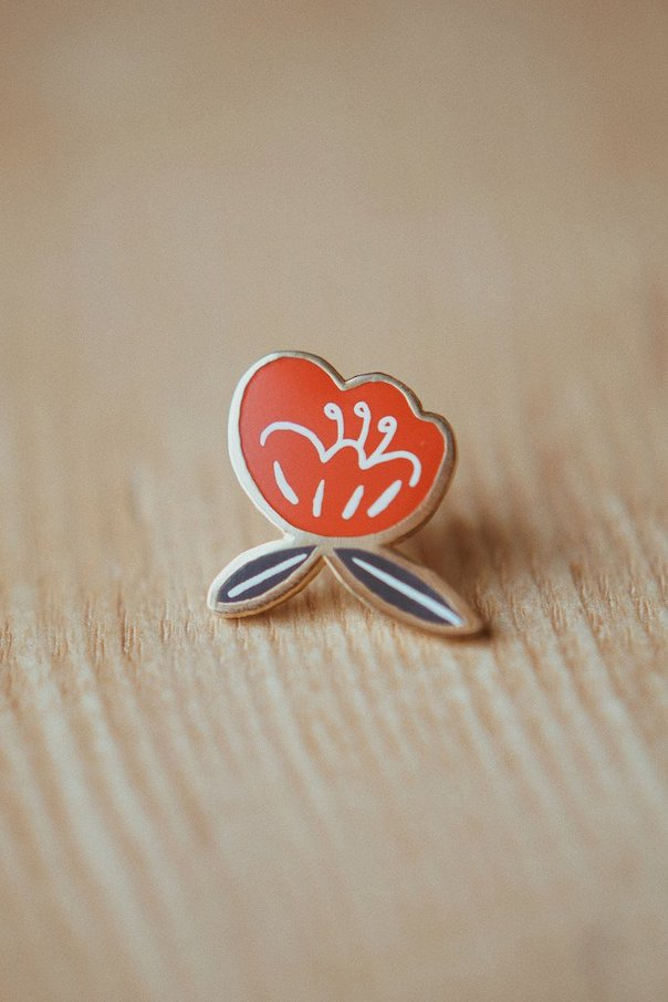 Shop  this poppin' Poppy petal pin  by Justine Gilbuena
