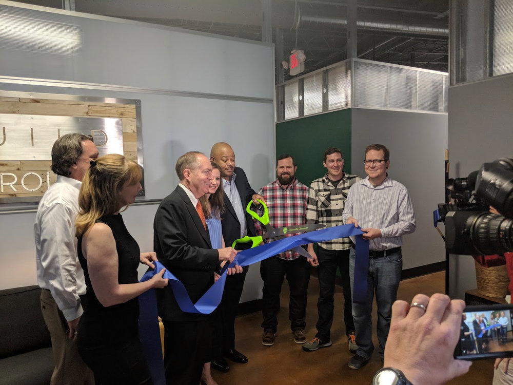 The Build Carolina/Carolina Code School team, joined by Mayor Knox White, Chamber president Carlos Phillips and NEXT CEO John Moore at our ribbon-cutting event on March 20.